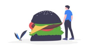 guy staring at hamburger for meals