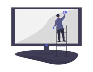 Man wiping down computer screen